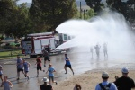 getting doused with the fire hose