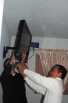 Morgan and Bac Vinh mounting the TV...