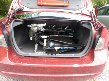 Real life puzzle.. how to fit two bikes in a small sedan..