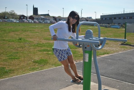 Taking a ride on the outdoor gym