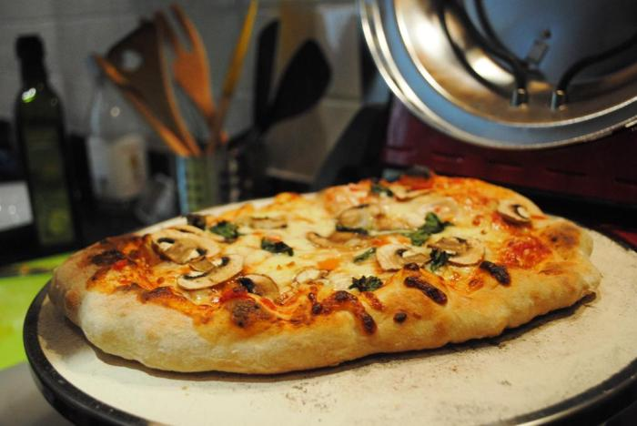 Third pizza out! Mushrooms and onions and basil