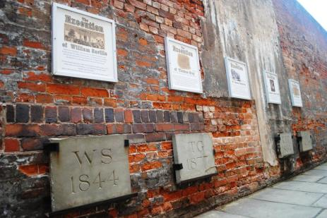 These blocks memorialize prisoners who were buried in the prison yard