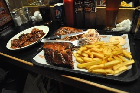 Half rack, chicken, pulled pork, fries, coleslaw and burnt ends