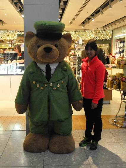 DECEMBER 2013 - Posing to Harrod's bear at LHR