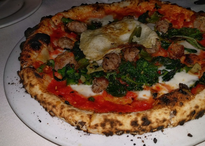 RAPINI - house-made fennel sausage, San Marzano tomatoes, mozzarella, rapini, chiles, fried egg